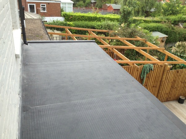 Asphalt flat roof construction, repair and replacement with EPDM Rubber Roofing Membrane