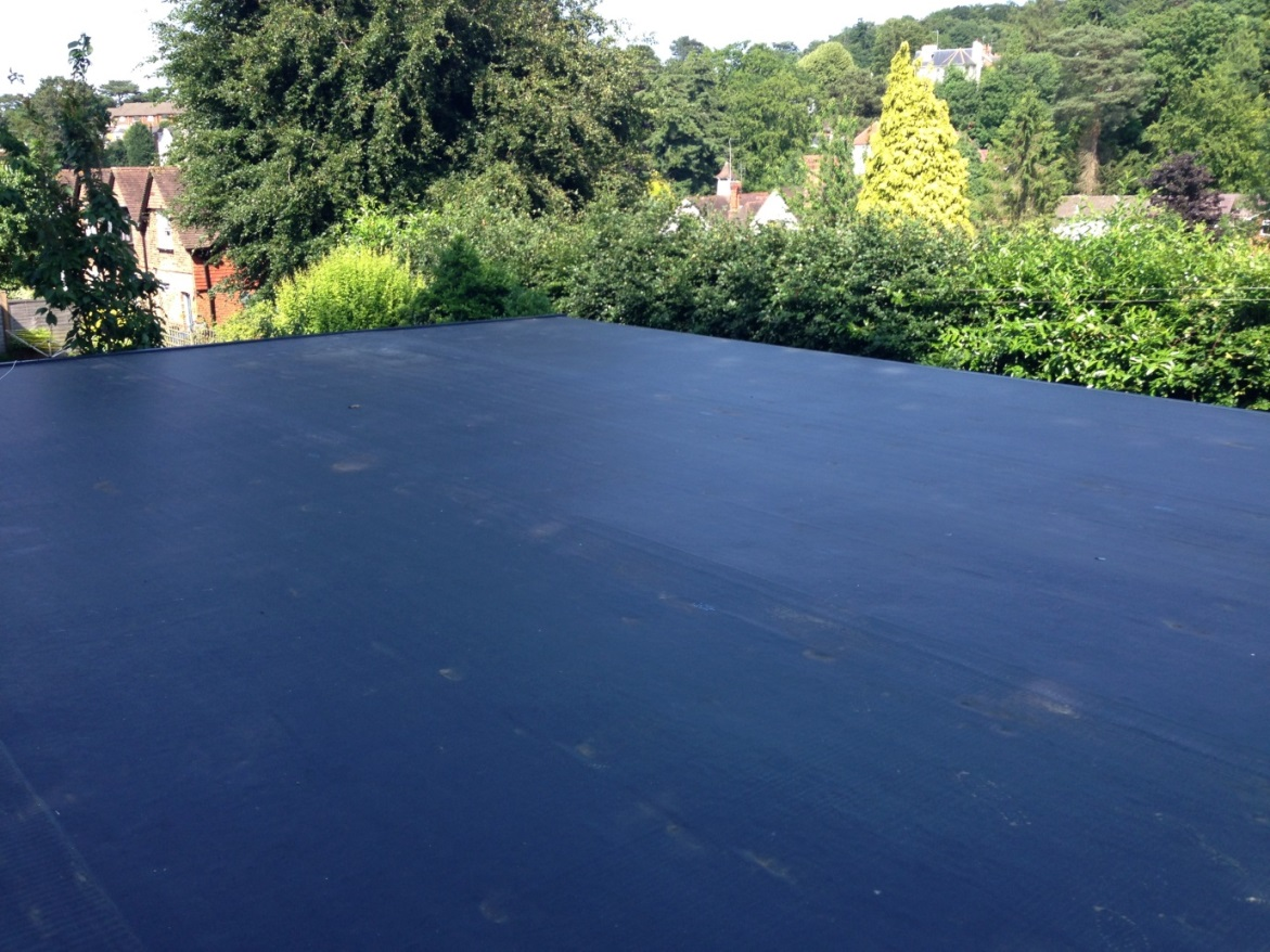 Commercial flat roof construction with the Duoply EPDM rubber roofing membrane