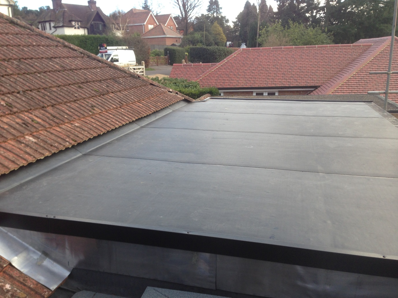 Dormer flat roof construction, repair and replacement with the Classicbond EPDM rubber roofing membrane