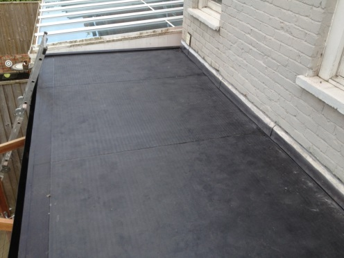Flat roof extension construction, repair and replacement with EPDM rubber roofing membrane