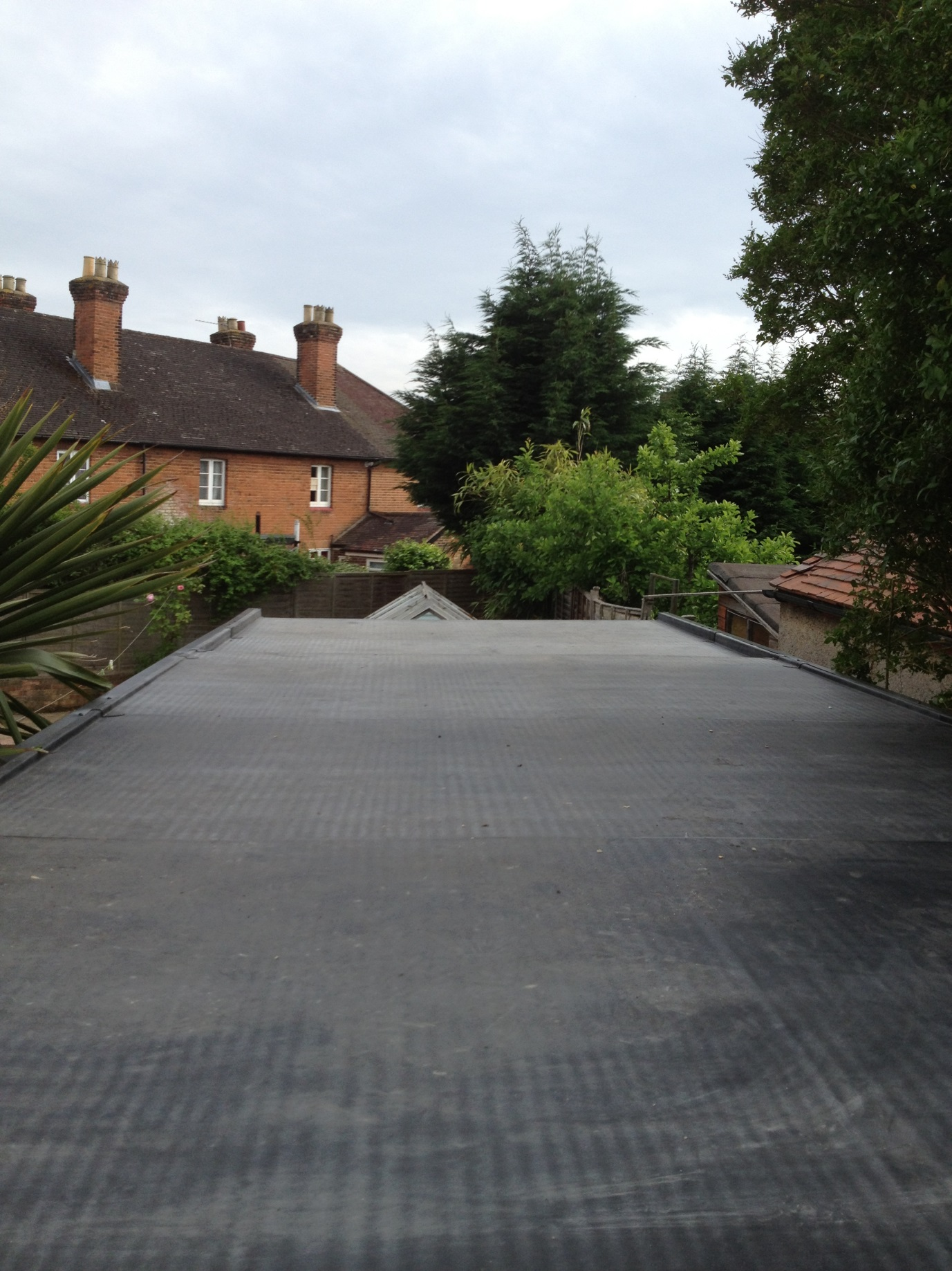 Flat garage roof construction, repair & replacement with an EPDM rubber roofing membrane