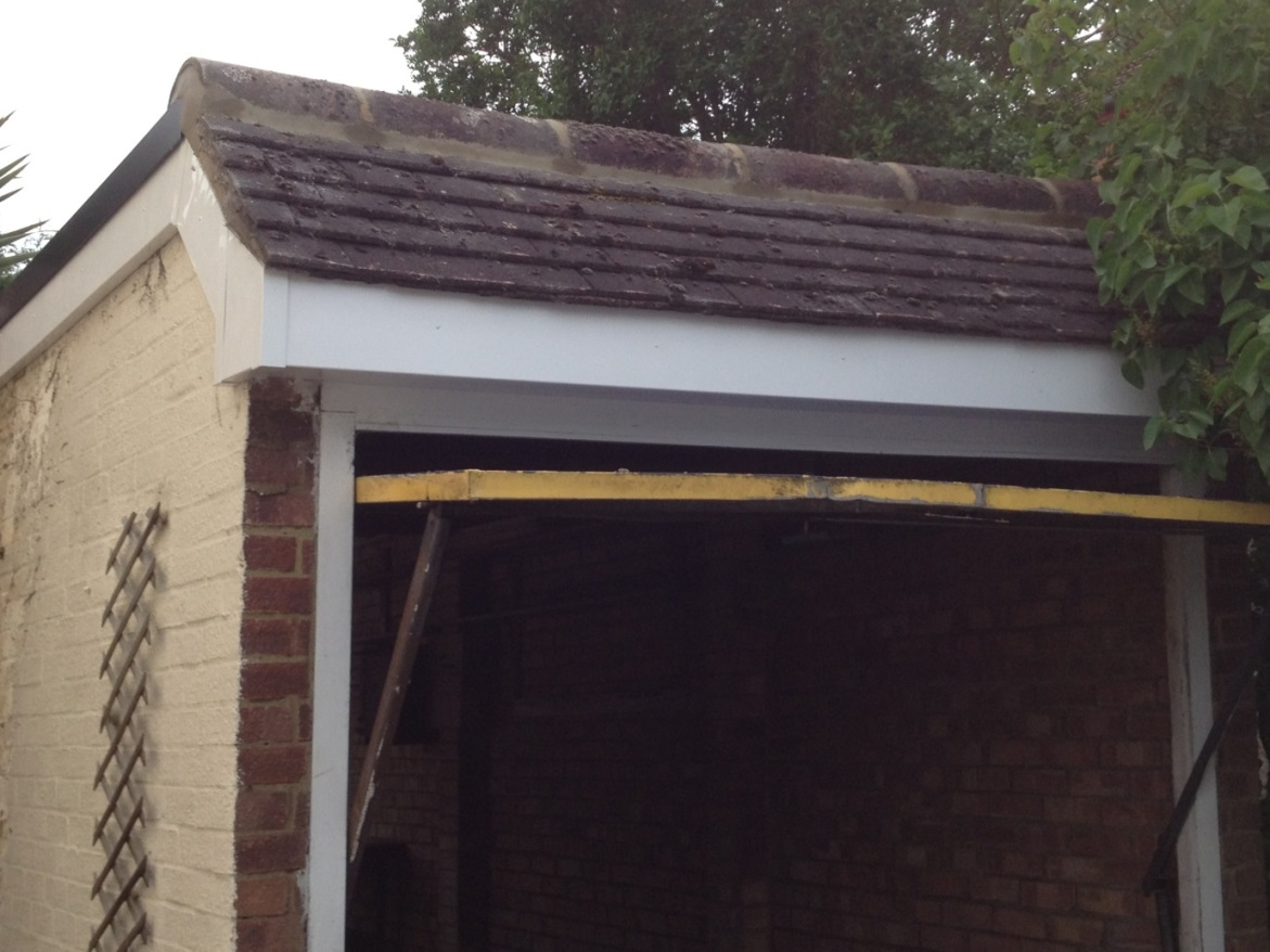 Flat garage roof repair & replacement with an EPDM rubber roofing membrane