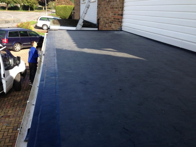 Porch flat roof construction, repair and replacement with a DuoPly fleece-reinforced EPDM rubber roofing membrane